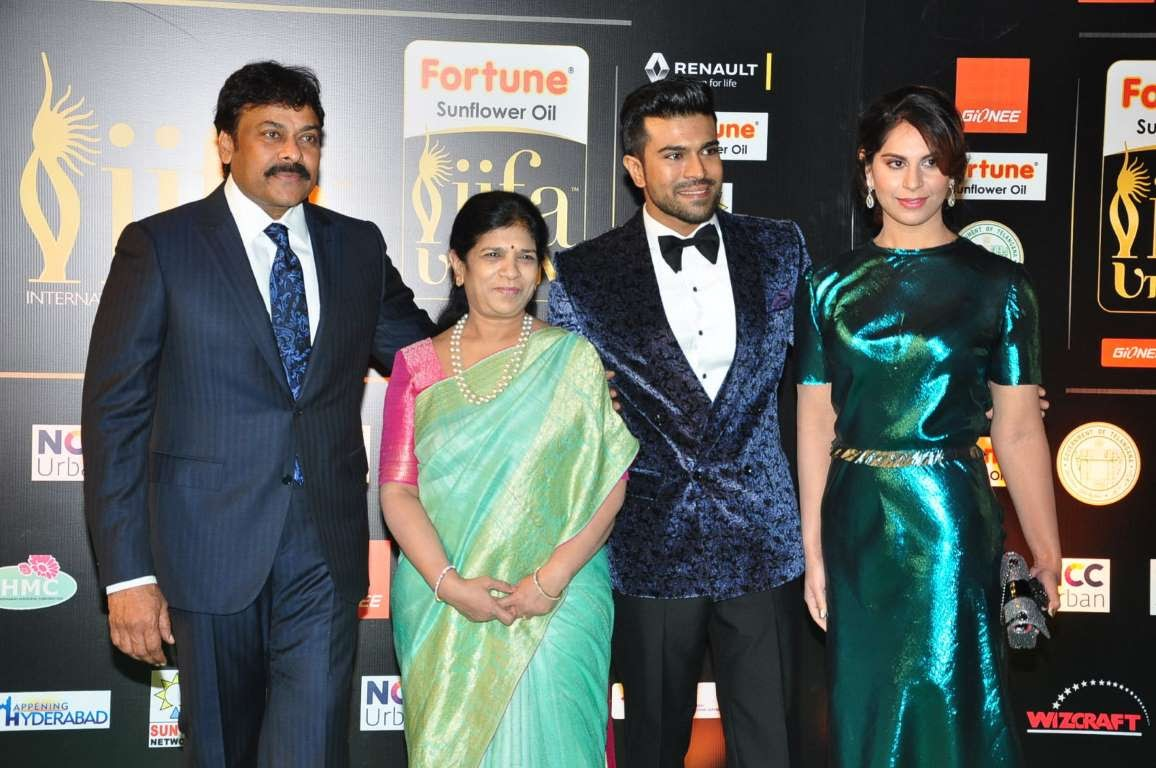 Chiranjeevi Surekha Konidala Ram Charan Teja and Upasna Kamineni pose for photographers upon arrival at IIFA Utsavam