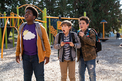 Movie still for the 2019 film Good Boys where Keith L. Williams, Jacob Tremblay, and Brady Noon play with a drone on a playground