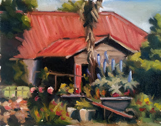 Oil painting of an old shed with a red roof surrounded by trees and shrubs, with a wheelbarrow in the foreground.