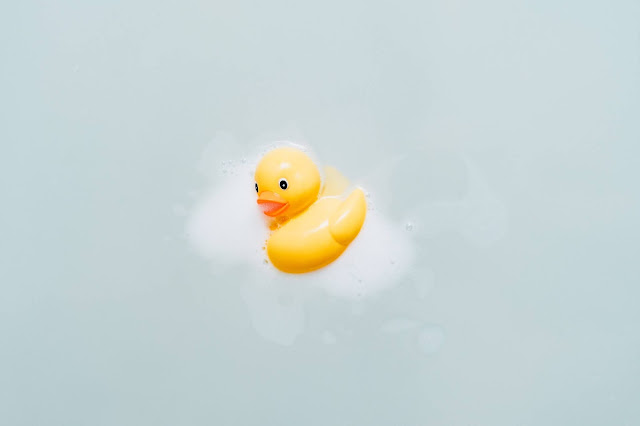duck in bubble bath. Photo by insung yoon on Unsplash