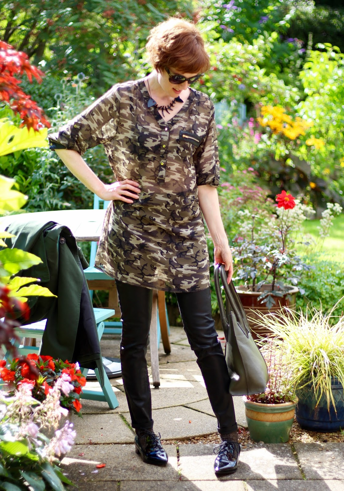 Fake Fabulous | Green Trench coat, camouflage sheer tunic, coated black jeans and patent shoes.