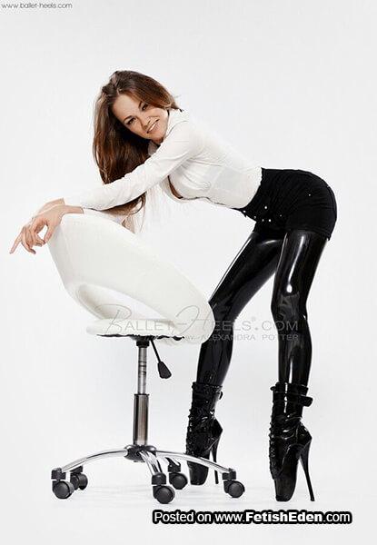 Hot Alexandra Potter wears black latex leggings and short black PVC ballet boots