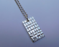 silver-woven-pendant-paper-clay-by-anna-campbell
