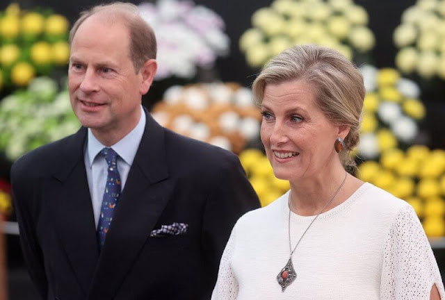The Countess of Wessex wore a new blouson sleeve knit midi dress from Victoria Beckham. Princess Anne and Princess Alexandra