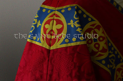 Red Gothic Revival vestments