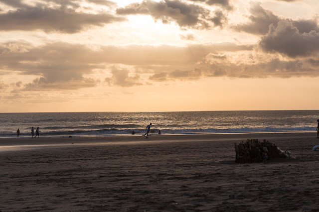 people playing football at seminyak beach in bali indonesia