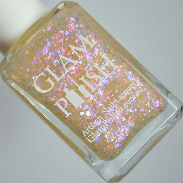 rainbow flakie nail polish in a bottle