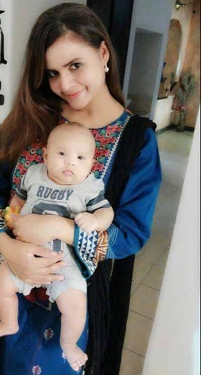 Beenish Chohan with her son