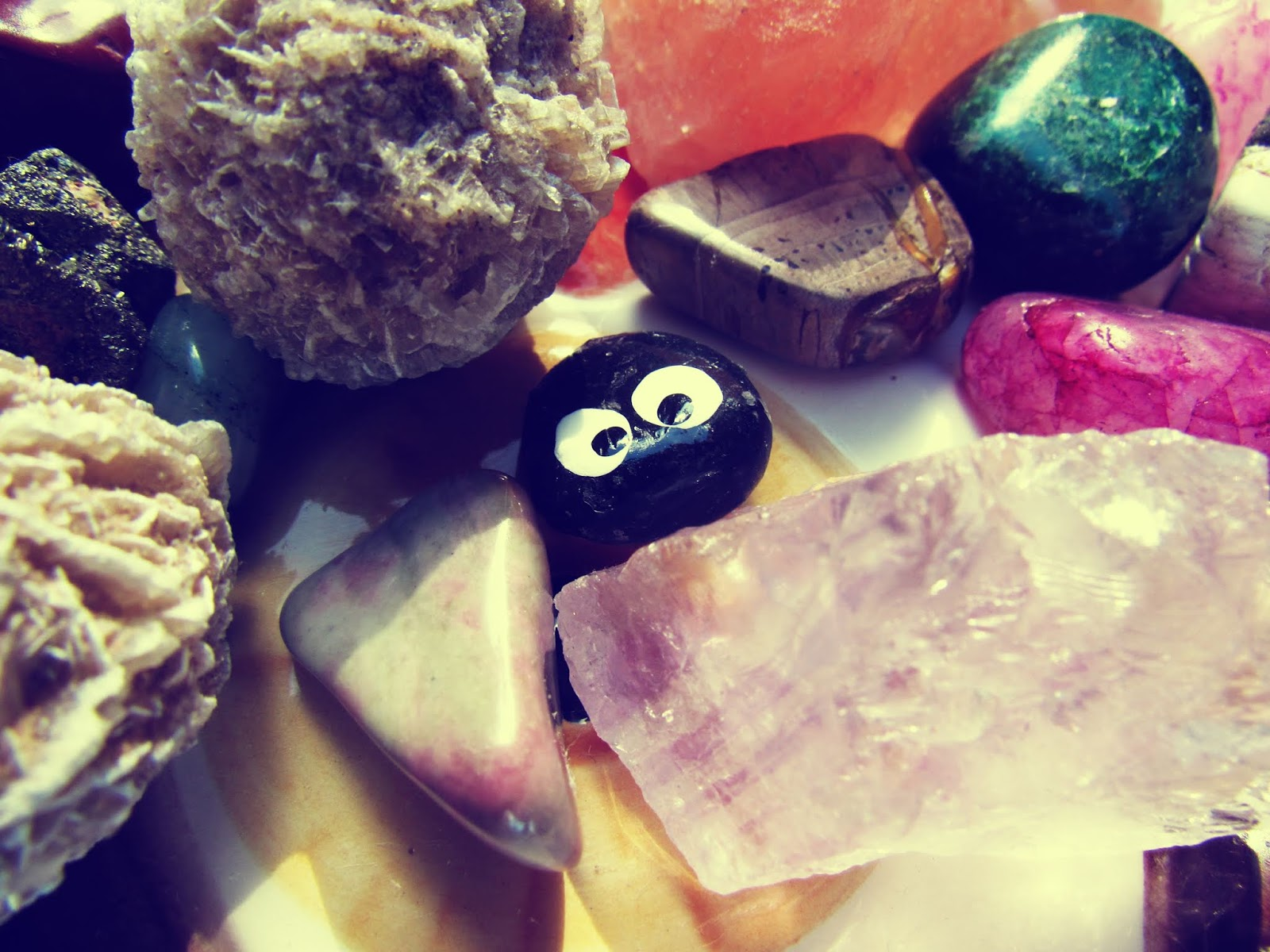 Healing stone assortment with fools gold, desert rose crystal, and a tiny black rock with a painted face