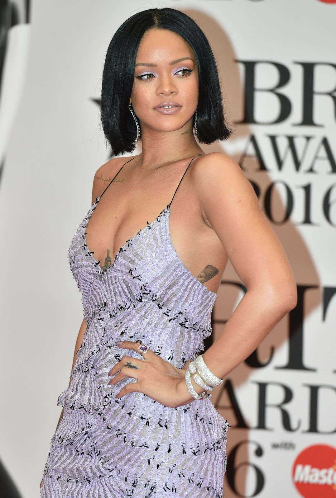 Rihanna goes braless at the Brit Awards 2016