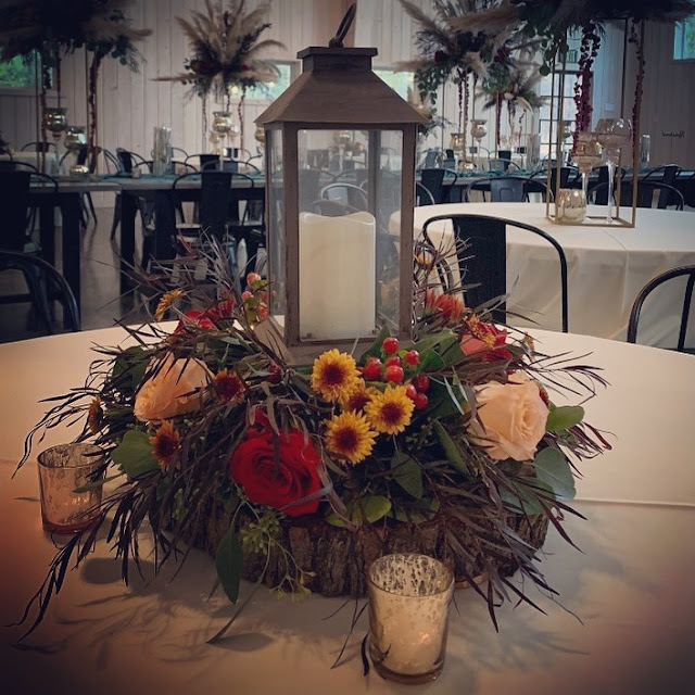 lantern centerpiece with fresh flowers