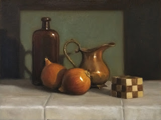 Still life oil painting of two onions beside a wooden cube, a copper jug and an antique bottle.