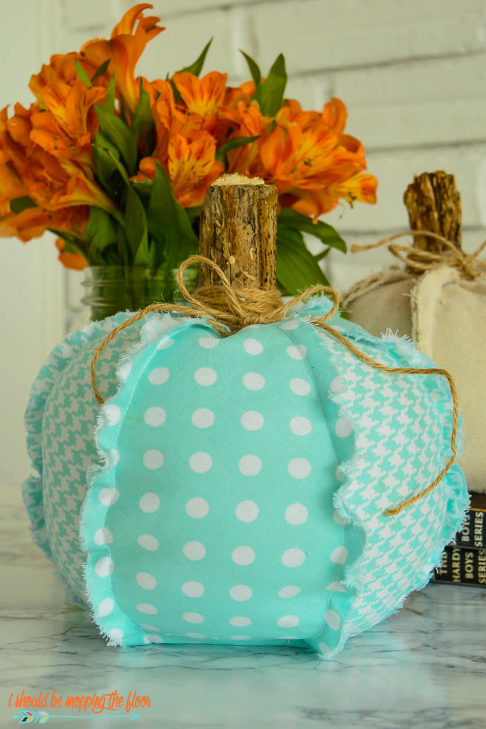 These easy fabric pumpkins have fun, outward frayed seams that give them a vintage, rustic look.  They're simple to make and budget-friendly, too.