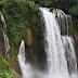 Trekking inside Pulhapanzak Falls