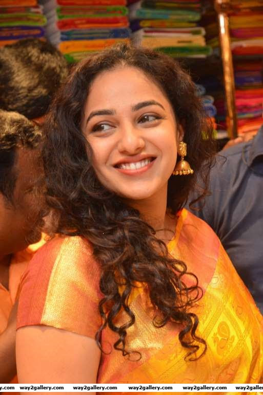 South Indian actress Nithya Menen is all smiles at the launch of a Kalamandir store