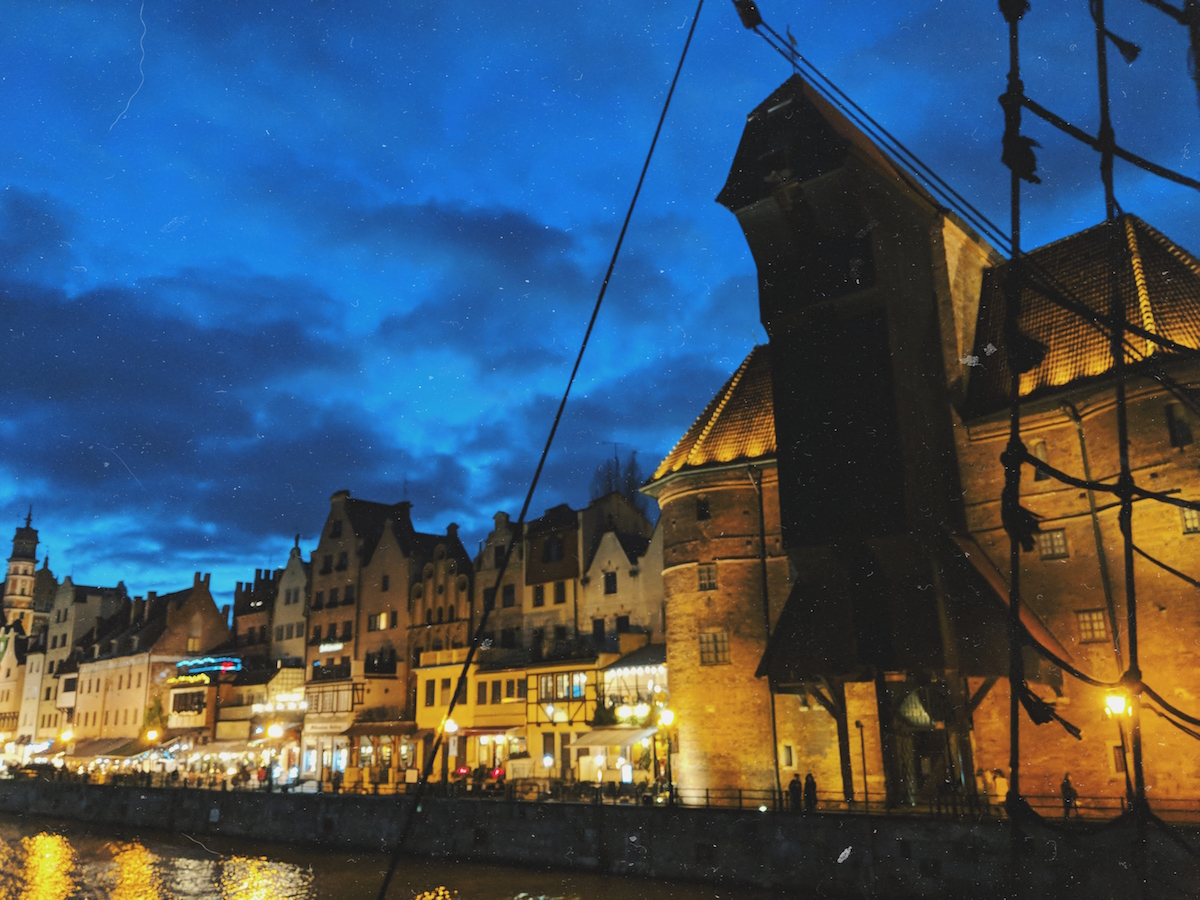 The historic crane of Gdańsk is distinctive against the waterfront