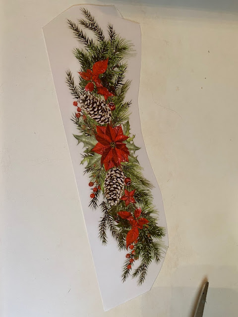 Photo of a Christmas swag decor transfer cut out for application.