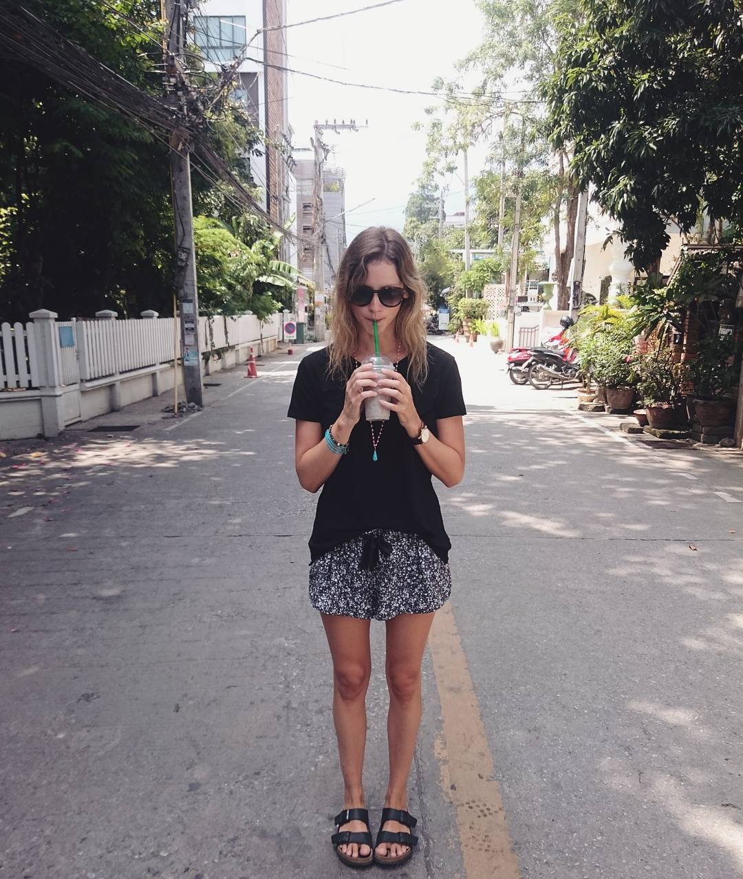 Travel blogger and digital nomad, Alison Hutchinson, is enjoying a smoothie on a hot day in the Nimman are of Chiang Mai, Thailand