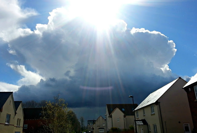 Blue Sky and Dark Cloud, with Sunshine Rays