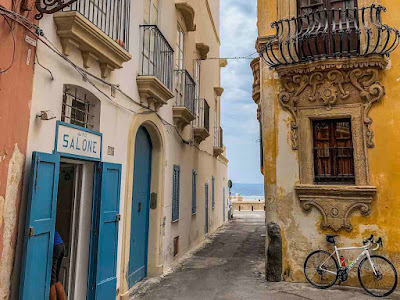 Cycling in Gallipoli village of Apulia region, Southern Italy