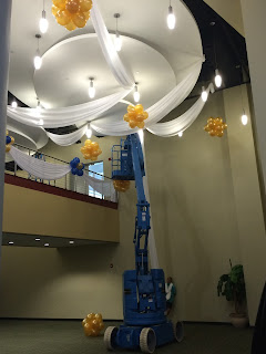 Ceiling draping with fabric and balloons