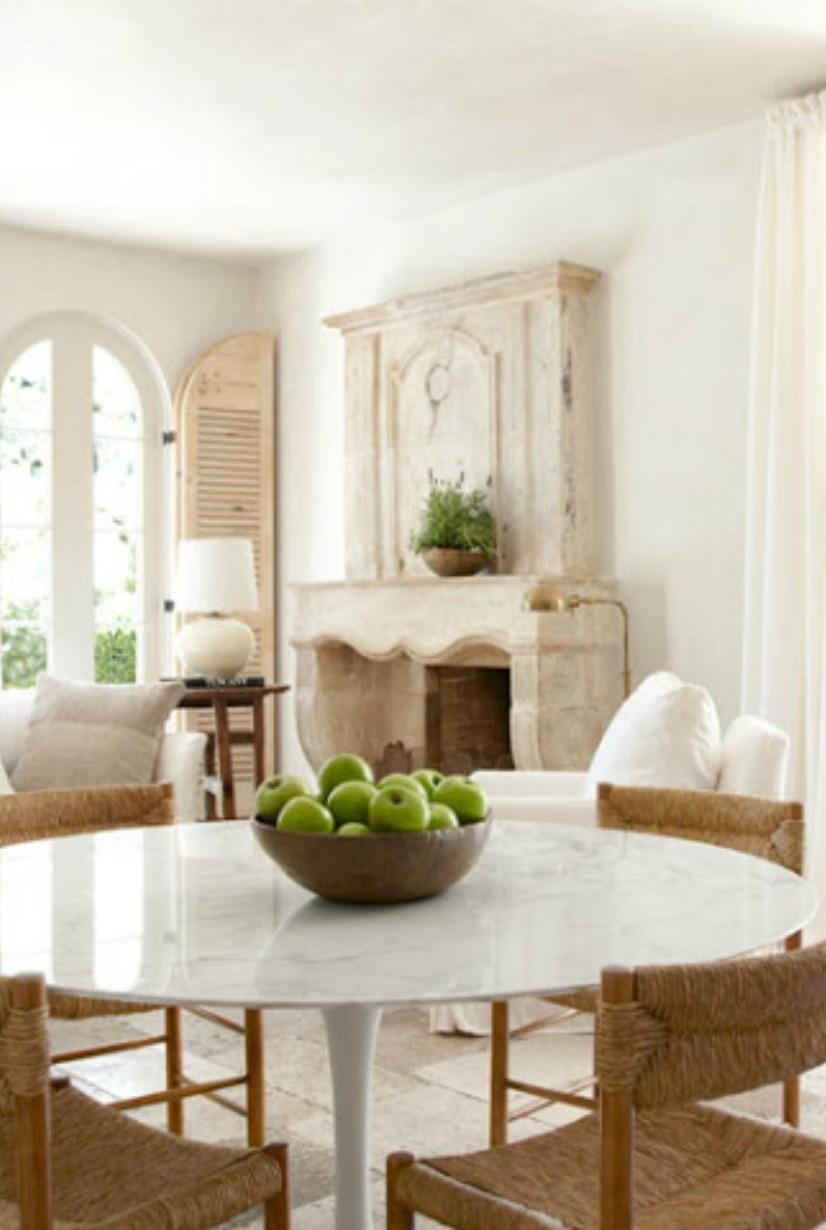 French farmhouse dining area with limestone fireplace - Pamela Pierce on Hello Lovely Studio