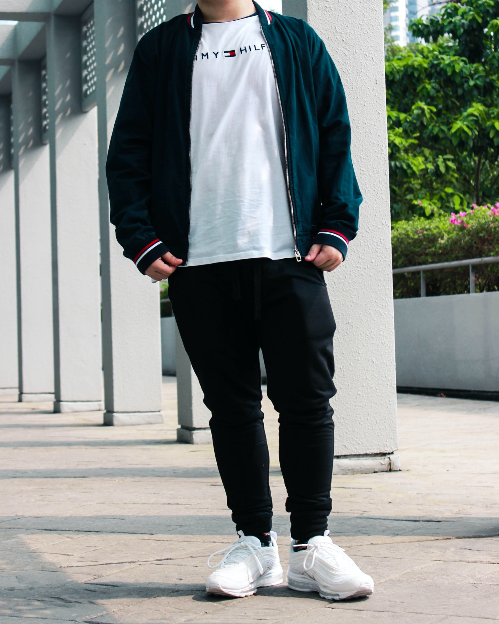 Man wearing, Bomber jacket over crew neck t-shirt and joggers.