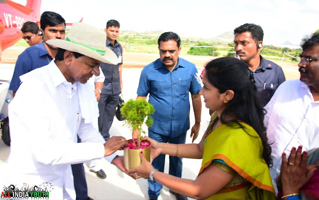 Telangana CM KCR Receiving gift from Swetha Mohanty