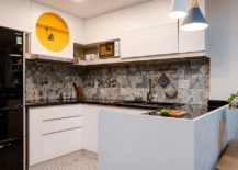 Bright tiles and pops of yellow and blue for the small kitchen in white x