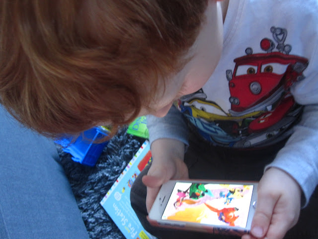 Little boy using the app