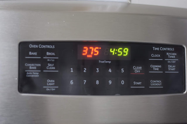 The oven preheating to 375 degrees.