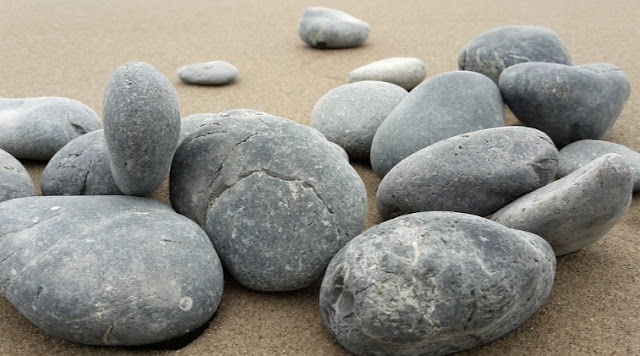 In life, face, pave, or fortify with stones