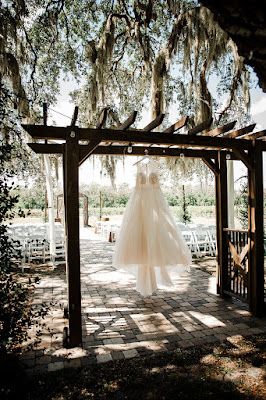 wedding dress hanging on arch