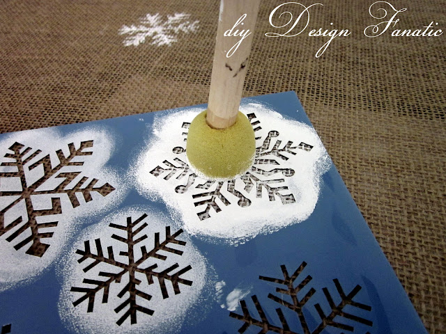 i used a snowflake stencil i found at hobby lobby awhile back and dabbed on some white acrylic paint randomly across the runner
