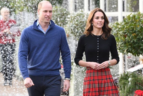 Kate Middleton wore Emilia Wickstead tartan pleated skirt. The Duchess wore a new cashmere cardigan by Brora