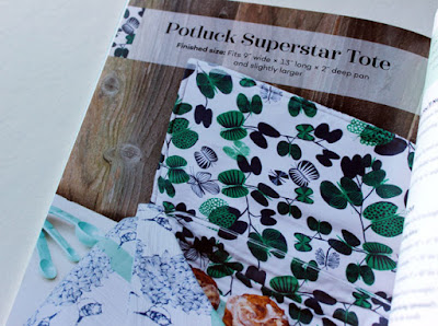 green and white potluck tote covering a dish