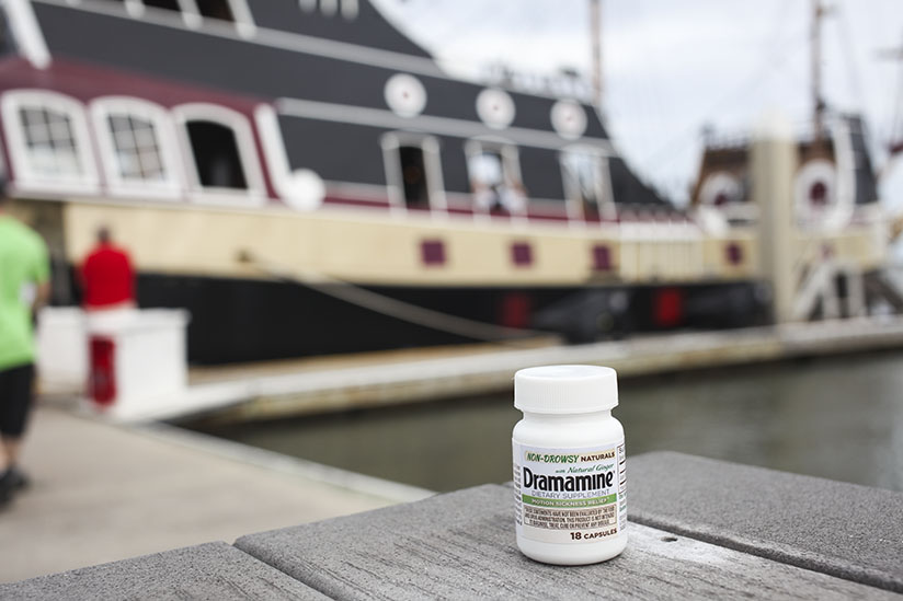 A bottle of Dramamine(R) in front of the Black Raven Pirate Ship