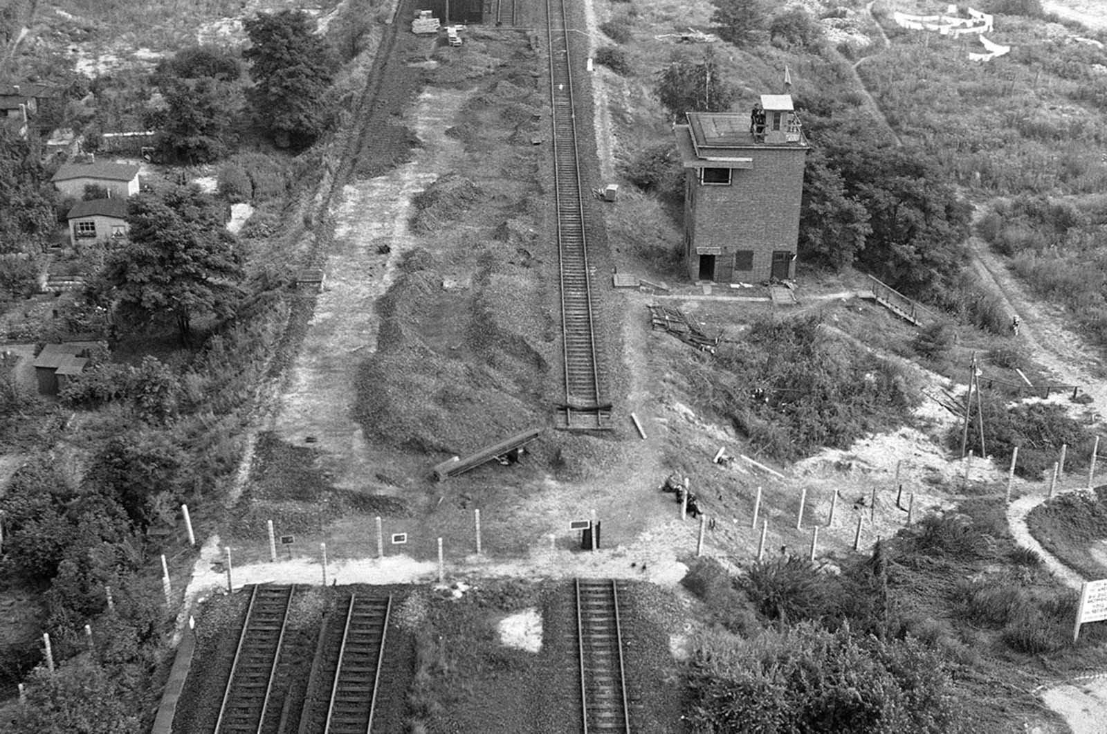 Tracks of the Berlin elevated railroad stop at the border of the American sector of Berlin in this air view on August 26, 1961. Beyond the fence, the Communist-ruled East Berlin side, the tracks have been removed.