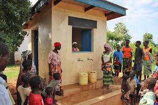 Parents fetching water at Langobaya Rotary club water Kiosk. PHOTO | RCF