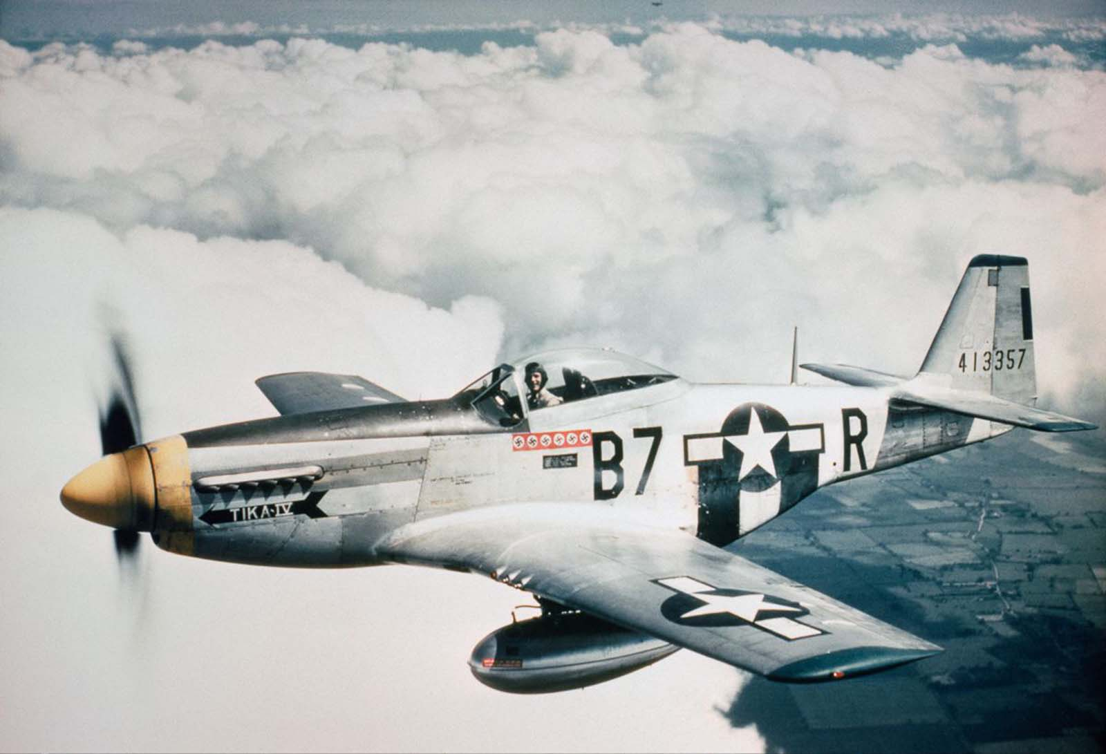 Lieutenant Vernon R Richards of the 361st Fighter Group flies his P-51D Mustang, nicknamed 'Tika IV', during a bomber escort mission. 1944.