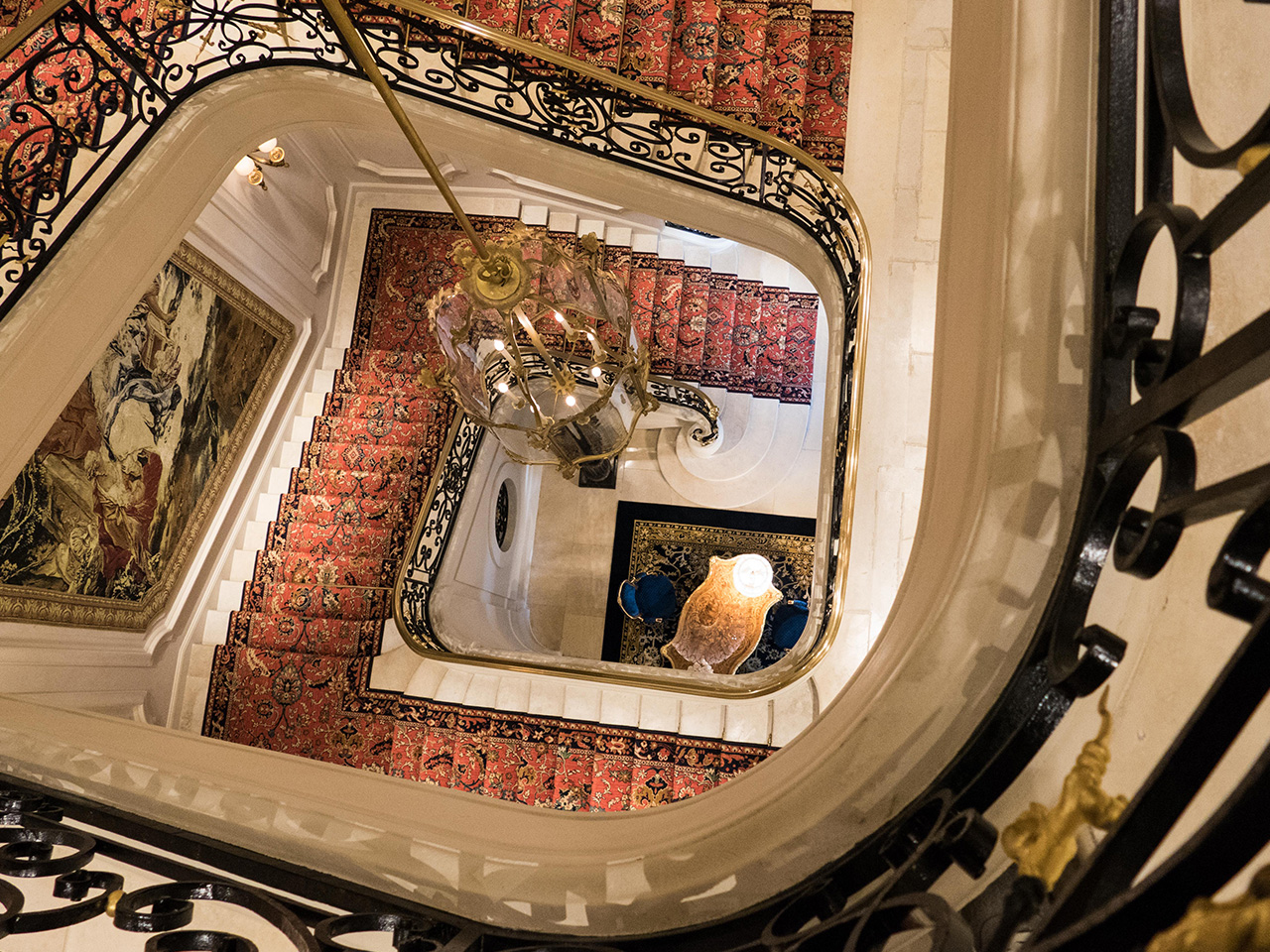 Winding wrought iron staircase at Ritz Paris Hotel