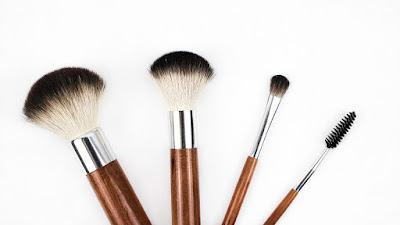 Four makeup brushes