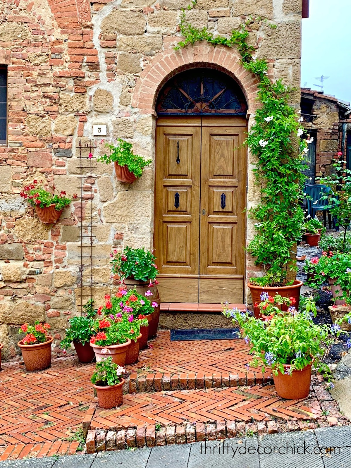 Tuscan exterior door decor with pots and flowers