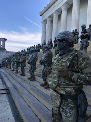 Rows of police in riot gear standing on steps of Lincoln Memorial