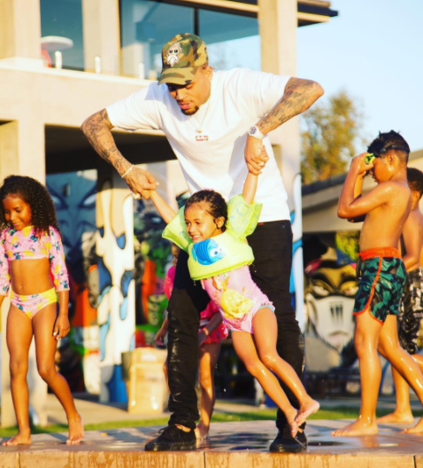 Hands on dad! Chris Brown takes his daughter swimming (photos)