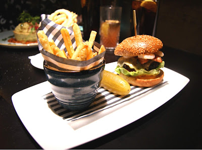 The Dirty Burger with cripsy bacon, lashings of cheese, beef dripping sauce and cripsy fries. He upgraded his burger with a side of prawns and a side order of cripsy onion rings.