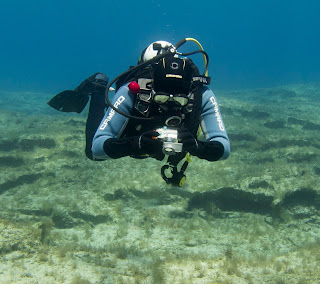 diver takes photographs underwater as part of training in cyprus