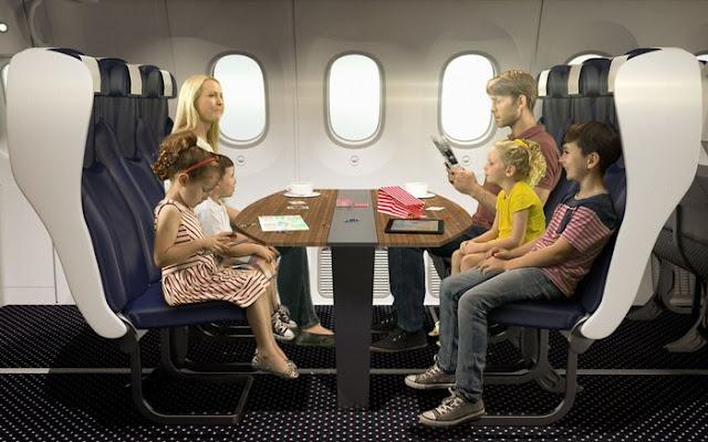 penumpang pesawat terdiri dari orangtua dan anak-anak duduk bersama-sama
