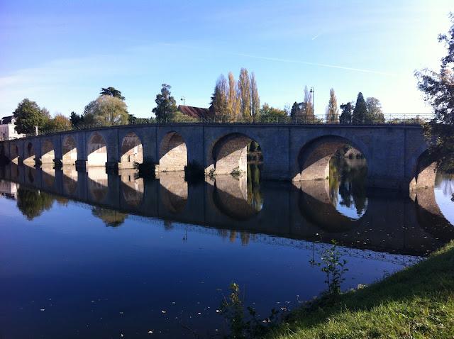 Bridge at Descartes reflecting on the river Creuse
