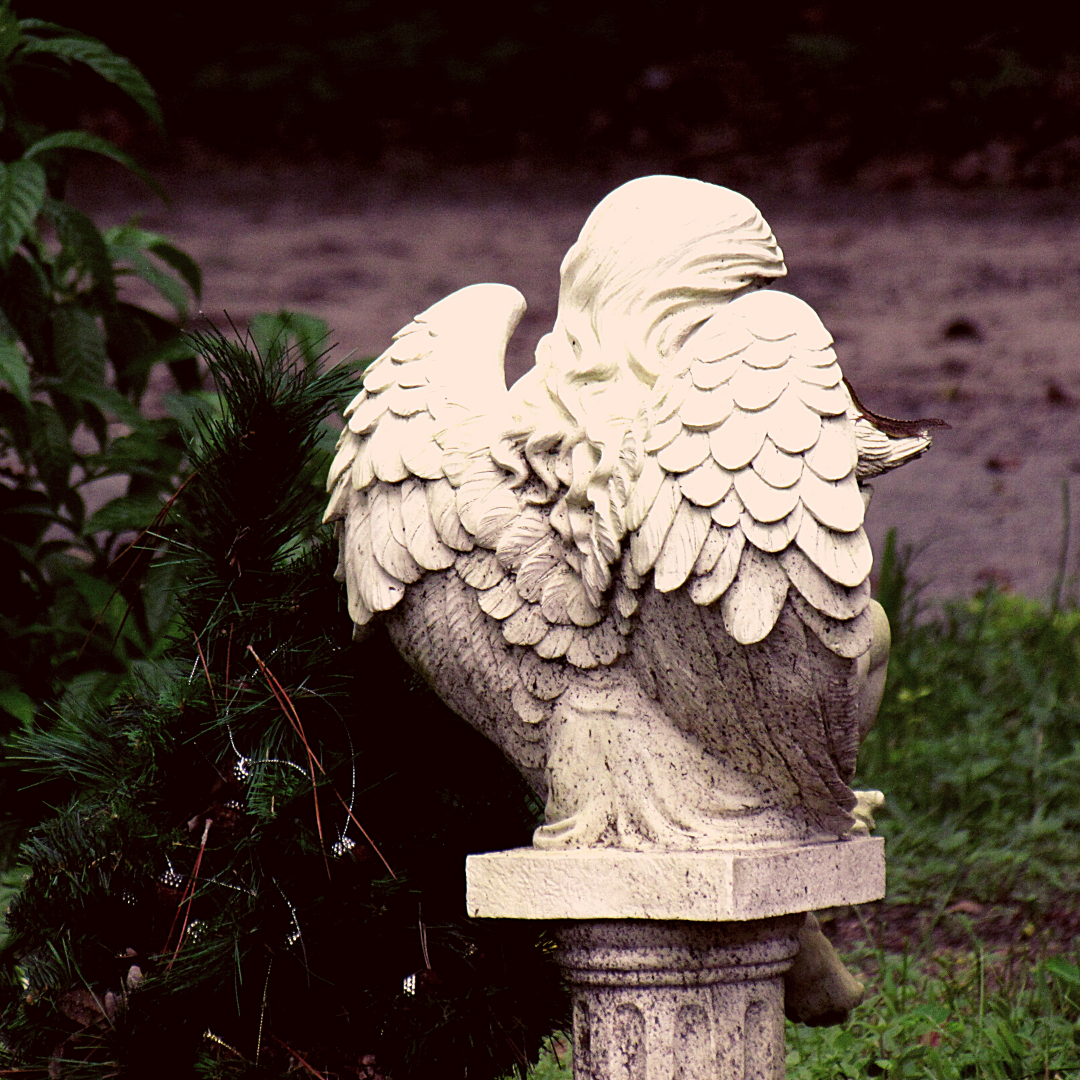 An angel statue in a public cemetery in historical Florida near Dunedin, Florida